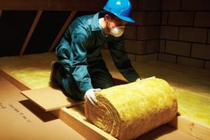 Installing glass wool loft roll