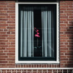What is the best way to soundproof an apartment window?